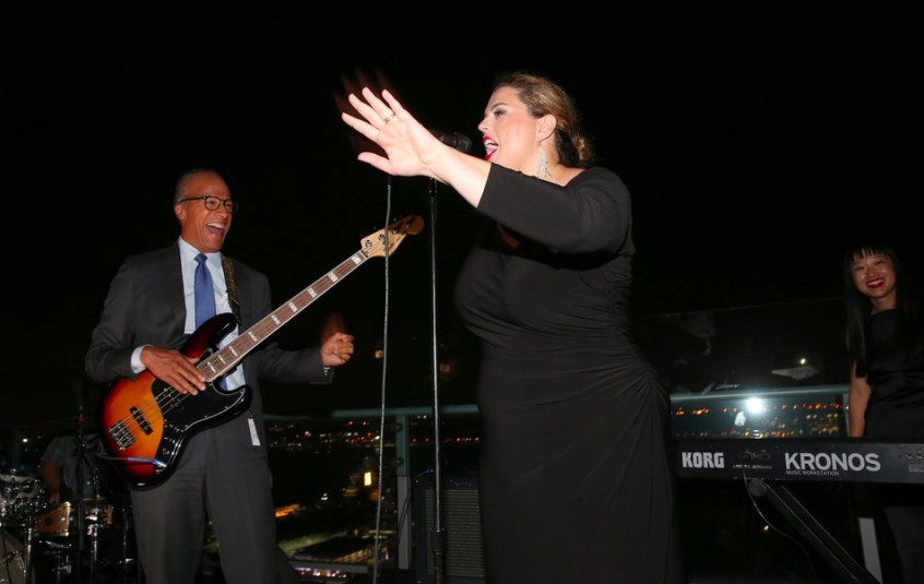 """Lester Holt plays bass with his band, the 30 Rockers, at the """"Dateline"""" 25th anniversary party Tuesday on a Manhattan rooftop. (Credit: Jemal Countess/NBC)"""