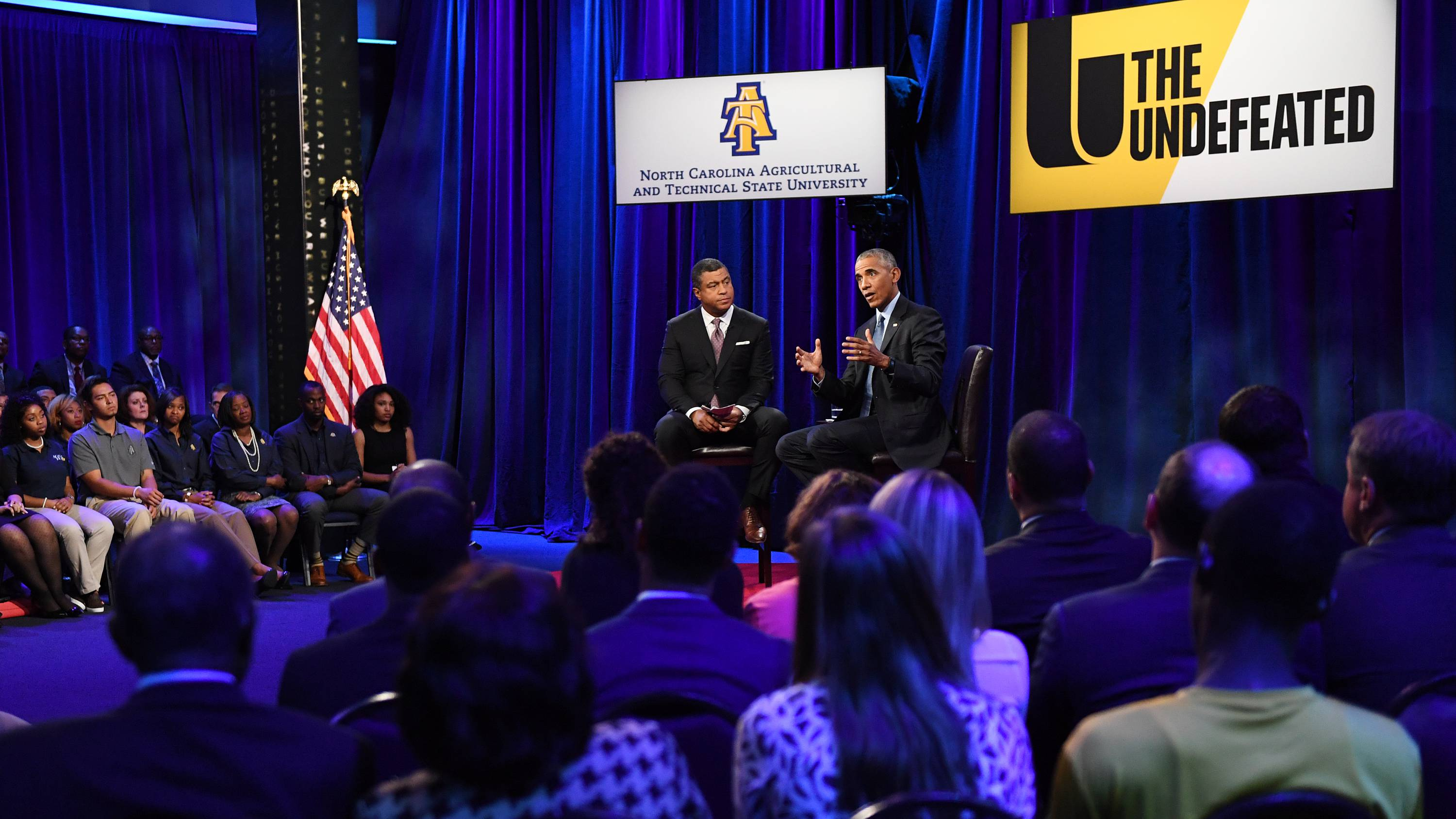 """President Obama and ESPN """"SportsCenter"""" anchor Stan Verrett, who hosted and moderated the town hall in Greensboro, N.C. """"ESPN's The Undefeated, a website devoted to sports, race, culture and historically black colleges and universities, has picked A&T specifically because of its size — it's the largest HBCU in the country — and prestige,"""" John Newsome reported for the News & Record in Greensboro."""