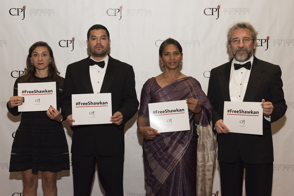 """American photojournalist Lynsey Addario, left, with International Press Freedom Awards honorees Óscar Martínez of El Salvador, Malini Subramaniam of India and Can Dündar of Turkey at the International Press Freedom Awards in New York on Tuesday. Photojournalist Mahmoud Abou Zeid, """"#Shawkan,"""" has been jailed for 1,000 days in Egypt; his ongoing incarceration is considered unlawful by several lawyers and human rights defendants as the maximum pre-trial detention in Egyptian is two years. (Credit: Barbara Nitke/Committee to Protect Journalists.)"""