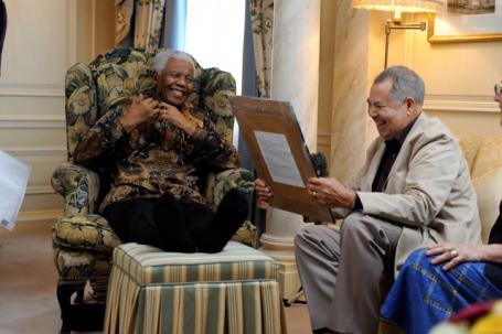 Lionel Morrison, right, with Nelson Mandela. (Credit: The Voice)
